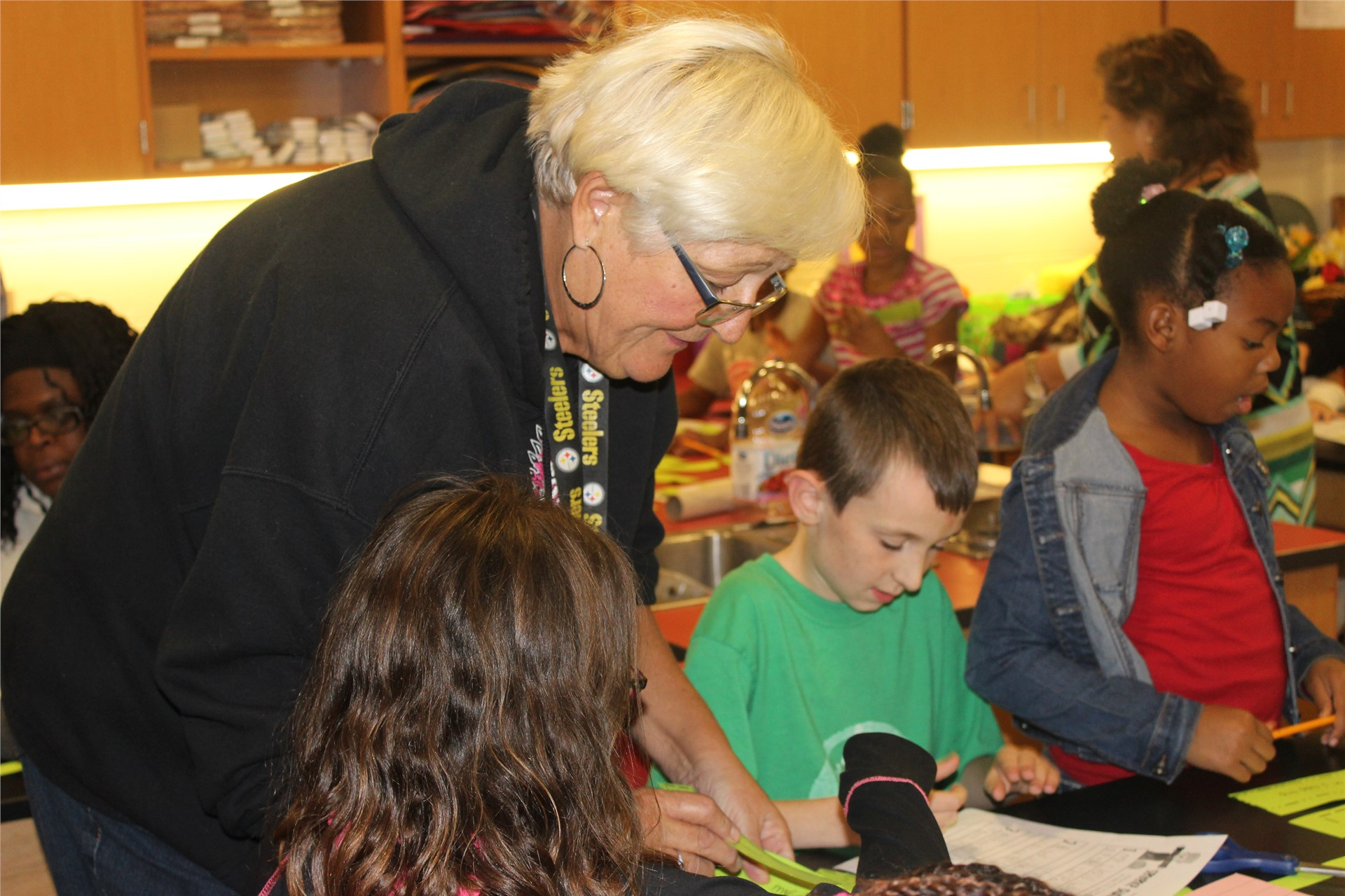 Retired Aliquippa teacher, Mrs. Postava, helped her grandchildren with the activities.