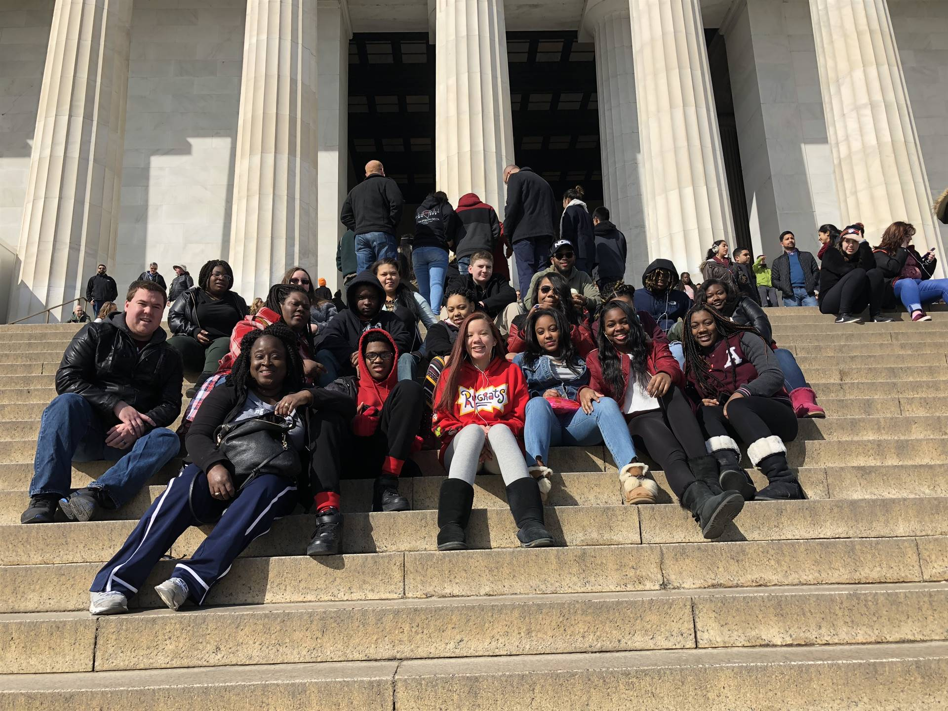 Students on the steps of a memorial